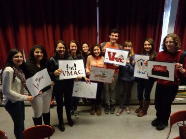 Students from VHS display their entries in the VMAC Logo Contest.