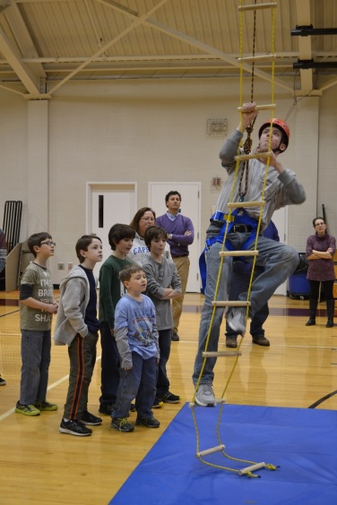 Connor McCann demonstrates the Rope Climb